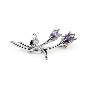 Jewelry - Rodium plated Floral broach w/ lavender CZ